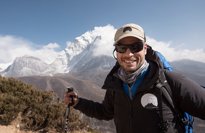 Emmanuel Daigle high-altitude hiking guide and LOWA Ambassadors smiling at the camera during an expedition in the Himalaya's